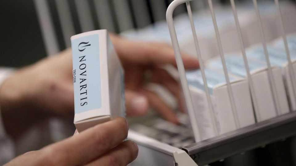A Novartis-labeled box is cataloged prior to testing procedures Tuesday, Aug. 14, 2018 at Banner Alzheimers Institute in Phoenix. Novartis and Amgen are making of two experimental drugs being tested to try to prevent Alzheimers while memory and think